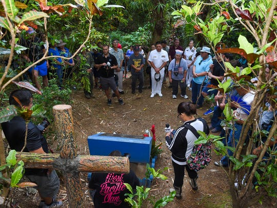Visitors gather for a prayer at the Tinta Massacre Site on its 73rd anniversary in Merizo, July 15, 2017.
