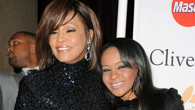 Whitney Houston and Bobbi Kristina Brown arrive at the 2011 Pre-GRAMMY Gala and Salute To Industry Icons Honoring David Geffen at Beverly Hilton on February 12, 2011 in Beverly Hills, California.