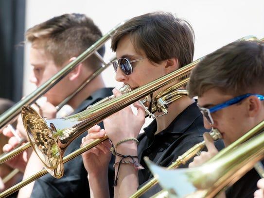 Senior Jordan McGinnis, center, plays trombone with