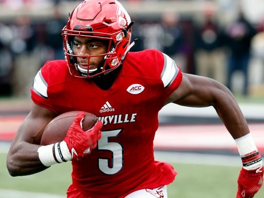 Louisville's Seth Dawkins returns a kickoff against