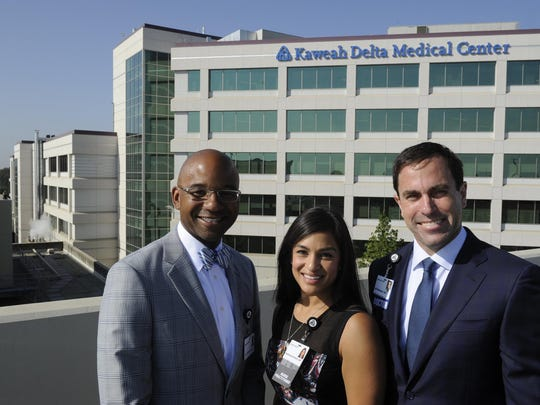 Dr. Ian Johnson, left, nurse practitioner Katherine Kimbro and Dr. Bill Whitlatch pose for a photo overlooking Kaweah Delta Medical Center. They make up the new neurosurgical team, the University Neurosciences Institute-Visalia.