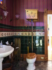 The downstairs bathroom of a Mason Victorian home features