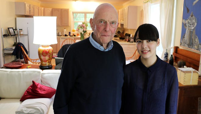 Jerry Yellin, a 91-year-old World War II veteran, stands in his home in Vedic City with his granddaughter from Japan, 19-year-old Sara Yellin. The ashes of Yellin's recently deceased wife of 65 years, Helene, sit in a wooden box visible in the right side of the photo, just beyond Sara's shoulder.