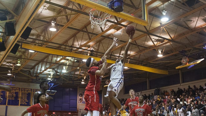 Camden's Corey Greer, center goes up for a layup against Medford Tech i Monday's South Jersey Group 2 Final at Clarence Turner Gymnasium. Greer led all scorers with 27 points in the win.