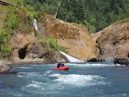"""Pete Biskind kayaks through the White Salmon River's """"lower lower section"""" of narrow canyons and a few waterfalls."""