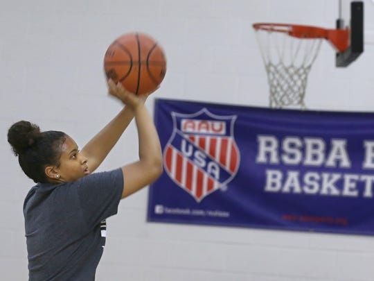 Jalen Nowden, a member of the varsity girls Harley-Allendale Columbia team, works on her long range jumpers at her AAU girls basketball practice at Reaves Sports Gym Monday, July 23, 2018 in Rochester.