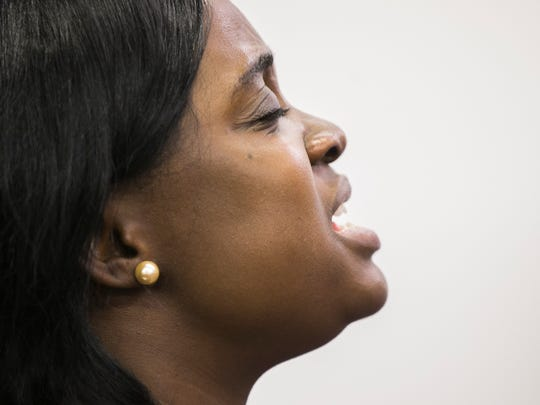 Belloh Gwesinie prays aloud during a Prayer against Ebola at Africa Faith Expressions Church in Phoenix, AZ on Sunday, Oct. 12, 2014.