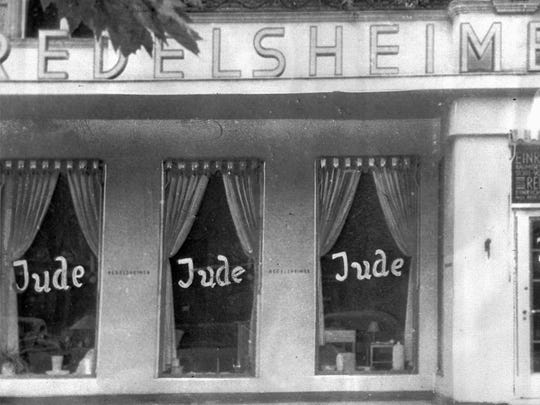 In this June 19, 1938 photo, the word Jude (Jew) is smeared on the windows of a shop in Berlin run by Jews. Nazi-incited mass riots left more than 91 Jews dead, damaged more than 1,000 synagogues and left some 7,500 Jewish businesses ransacked and looted.
