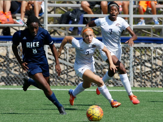 Rice midfielder Jasmine Isokpunwu (8) advances the ball as UTEP forward Kobi McNutt (3) attempts to catch up to her to try and regain control of the ball in action Sunday afternoon.