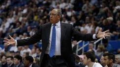 Memphis Tigers head coach Tubby Smith watches from