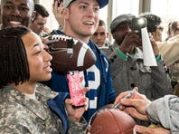 Colts coach Chuck Pagano, Andrew Luck and Dwayne Allen are traveling to visit U.S. troops.
