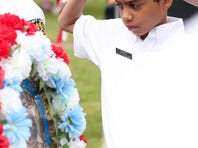 Ceremonial wreaths are presented during the 35th annual Memorial Day service by the Greater Salem Area Veterans Organizations at City View Cemetery in Salem on Monday, May 25, 2015.