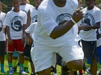Trent Richardson of the Oakland Raiders, instructs young players Saturday during the Trent Richardson Football Camp at Escambia High School.