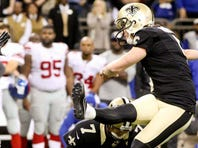 Saints defensive end Bobby Richardson puts a hit on Giants quarterback Eli Manning during the second half Sunday at Mercedes-Benz Superdome. New Orleans defeated New York 52-49.