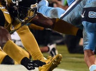 Titans running back David Cobb (23) eludes Jaguars strong safety Johnathan Cyprien during the second quarter on Nov. 19 in Jacksonville.