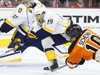 Predators goalie Pekka Rinne, center, fails to stop a shot by the Flyers' Michael Del Zotto, left, with Nashville Predators' Eric Nystrom, right, looking on in the first period Friday.
