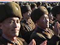 This picture released from North Korea's official Korean Central News Agency on Nov. 8, 2015, shows Kim Jong Un  attending a photo session with military education officers.