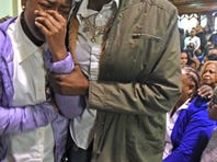 Nate Plummer Jr.'s parents, Taisha Mercado and Nate Plummer Sr. at the funeral for Nate Plummer Jr. at Tabernacle of Faith Church in Camden Monday.  Daughter Natijah Plummer, 10, is standing and applauding because the crowd was asked to clap for his parents; at left is Mercado's daughter, Milan Boyd, 5.