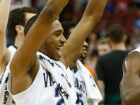 Villanova's Phil Booth celebrates after the Wildcats defeated the Miami Hurricanes.  Mar. 24, 2016