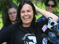 Tracey Stewart, wife of comedian Jon Stewart, shows off Lily to the media after she officially adopted the abused mare found at auction stable in New Holland, Pa., in March.