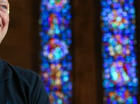 Alan Peterson, an emplyee of Willet Hauser, a stained-glass window repair company, is inside Duncan Memorial Chapel.