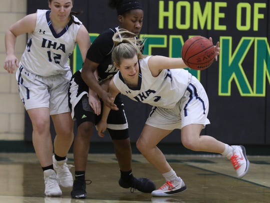 Samantha Rinaldi of IHA and Janel Moore of Paramus Catholic both helped their teams to victory in Saturday's Bergen County girls basketball quarterfinals. (File photo)