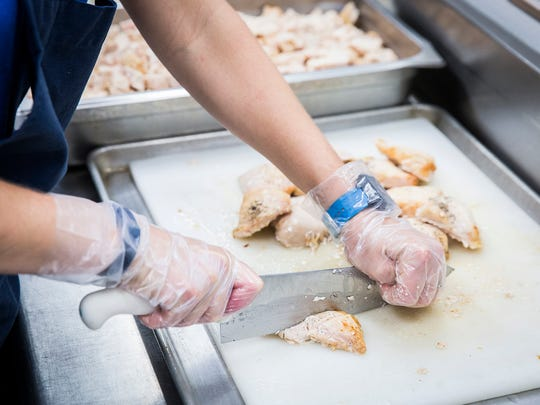 Volunteers prepare food for local children at Fresh Directions in Muncie Thursday afternoon.