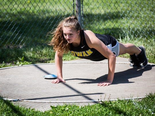 Cowan's Kaily Smith warms up before throwing at Cowan