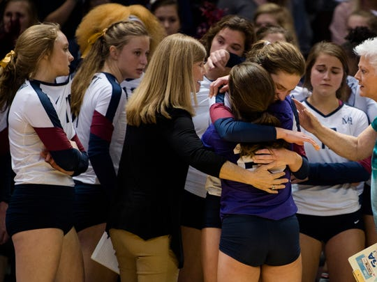 Montgomery Academy's Morgan Karst (13) embraces Montgomery Academy's Ann Lucas Herrick (20) after the AHSAA Class 3A State Volleyball Championship between Montgomery Academy and Bayside Academy on Thursday, Nov. 2, 2017, in Birmingham, Ala. Bayside Academy defeated Montgomery Academy in the fifth set 15-13.