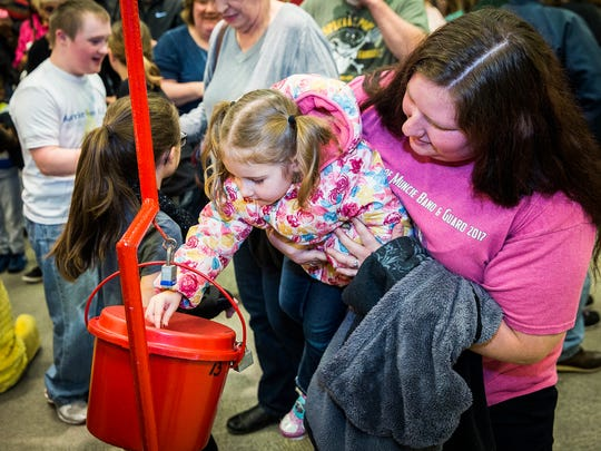 Attendees donate following the Red Kettle Campaign kick-off at the Muncie Mall in mid-November 2017. The Salvation Army is attempting to raise $160,000 for its 2018 services.
