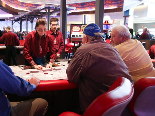 A dealer cuts the cards at a blackjack table at Resorts World Catskill Casino in Monticello on Thursday, February 8, 2018.