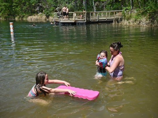 Kora and Paige Voigt enjoy the cool waters of Quarry 11 with their mother Jodi Friday, May 25, at Quarry Park and Nature Preserve in Waite Park.
