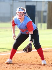 Zoey Neal waits in position at third base during Gibson