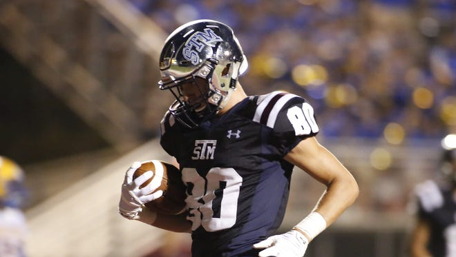 St. Thomas More's Griffin Hebert scores during the Cougars' Superdome season of a year ago.