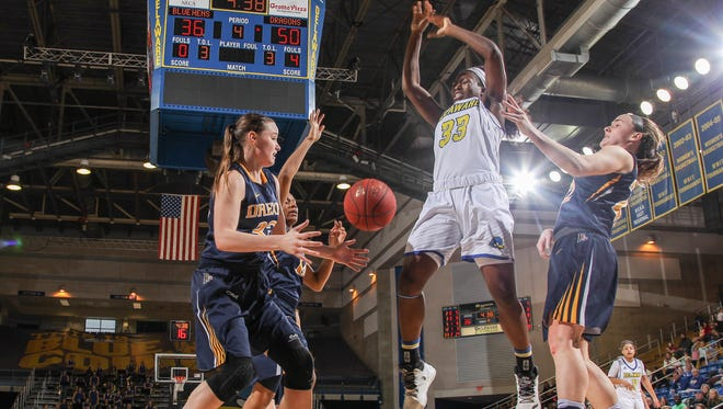 Delaware forward Nicole Enabosi (33) has the ball stripped while driving to the basket as Drexel guard Meghan Creighton (22) defends in the second half of Drexel's 54-44 win at the Carpenter Center.