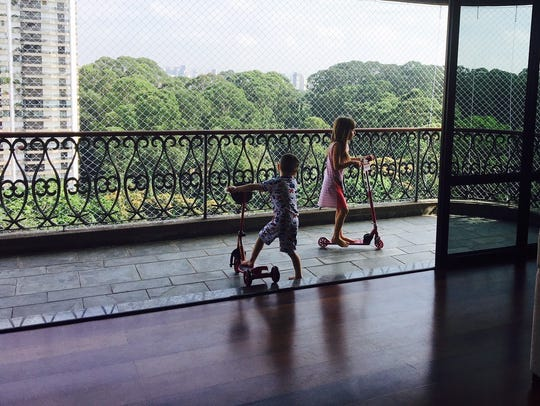 Leo and Stella Oliveira ride their scooters on the