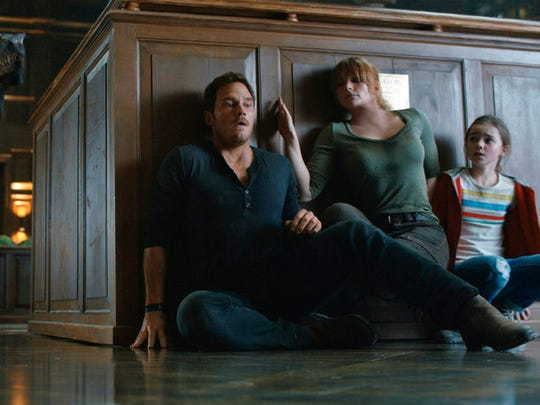 "From left, Chris Pratt, Bryce Dallas Howard and Isabella Sermon star in ""Jurassic World: Fallen Kingdom."""