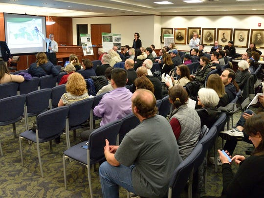 Dozens of area residents listen to EPA and Honeywell officials explain what they plan to do to limit noxious fumes from the Quanta Superfund site in Edgewater at a meeting in March.
