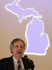 University of Michigan professor George Fulton , pictured here in 2006, presents an annual forecast on Michigan's economy.