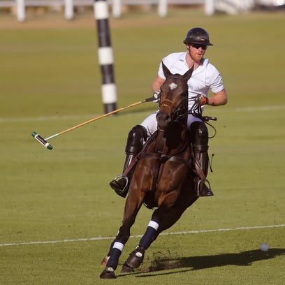 Prince Harry plays during the Royal Salute Polo Cup.