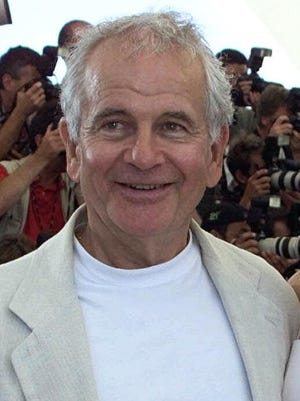 """British actor Ian Holm, left, and American actress Summer Phoenix, smile as they pose during a photocall for their film """"Esther Kahn"""" directed by French Arnaud Desplechin, being shown in competition for the Golden Palm, at the Film Festival in Cannes, France, Friday May 19, 2000"""