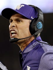 Washington head coach Chris Petersen argues a call with an official during the first half of an NCAA college football game against Stanford Friday, Nov. 10, 2017, in Stanford, Calif. (AP Photo/Marcio Jose Sanchez)
