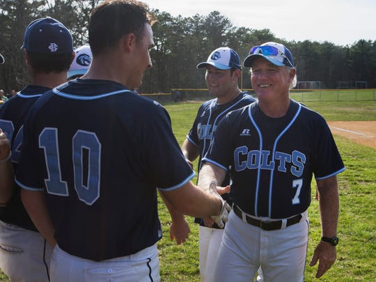 CBA Coach  Marty Kenny gets congratulations on his 800th win from player Andrea Delatri and other players. CBA baseball defeats Wall in seventh inning heroics during Strikeout Autism Baseball Challenge at Central Regional High School in Berkeley on April 14, 2018.