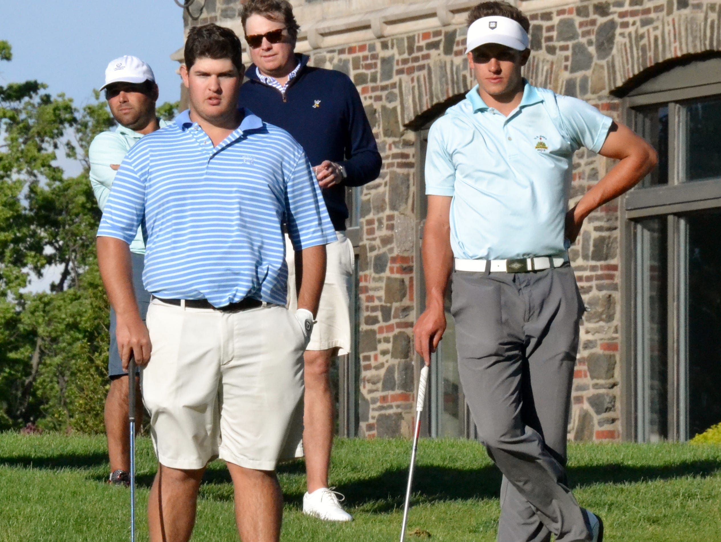 Chris Troy (left) and James Nicholas watch Andy Cooper and Craig Hurlbert putt on the 18th hole at Winged Foot West in the championship of the Anderson Memorial.