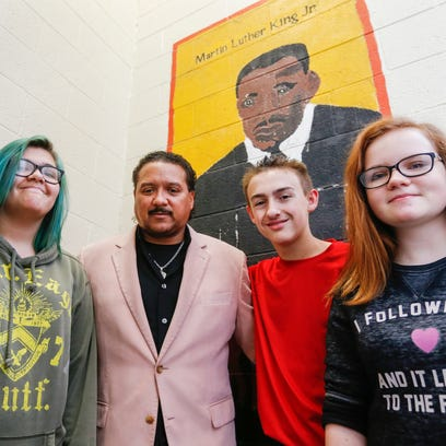 From left, Knowianna Cortes, 14, Roland Young, Spencer