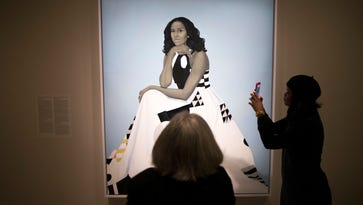 The Obama portraits draw visitors to the nation's capital