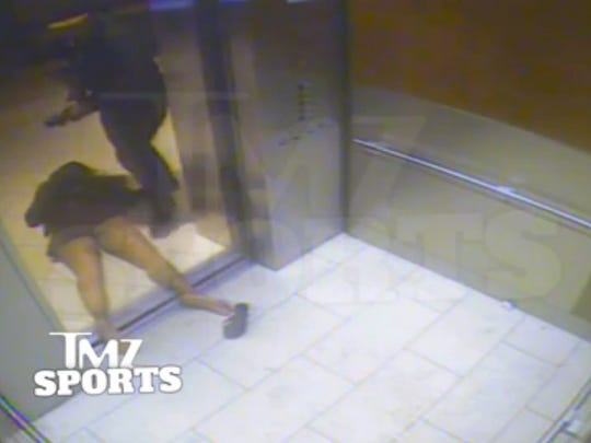In this still image taken from a hotel security video released by TMZ Sports, Baltimore Ravens running back Ray Rice drags his then-fiancee, Janay Palmer, out of an elevator moments after knocking her off her feet into the elevator's railing at the Revel casino in Atlantic City, N.J., in February 2014.