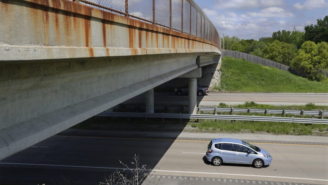 Rust from a chain-link fence stains the South Telulah Avenue bridge over State 441 in Appleton.
