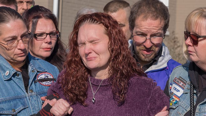 A distraught Rose Hunsicker, center, the biological mother of Grace Packer, is escorted to the church by members of her family and members of Bikers Against Child Abuse Monday, Jan. 16, 2017, on her way in to a memorial service for Packer, the local teen who who authorities say was killed and dismembered by her adoptive mother and her boyfriend, at the New Life Presbyterian Church in Glenside, Pa.