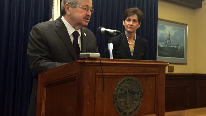Gov. Terry Branstad talks with reporters on April 24, 2017 as Lt. Gov. Kim Reynolds listen.